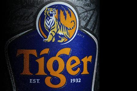 The logo of Tiger beer is pictured on a can of ice cold beer in Singapore July 20, 2012. REUTERS/Tim Chong