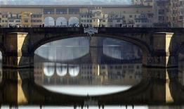 People stroll downtown Florence November 20,2011. REUTERS/Giampiero Sposito