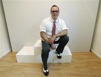 Shoe designer Christopher Ciccone, who is Madonna's brother, poses for a portrait before the presentation of his Spring/Summer 2013 collection at London Fashion Week September 14, 2012. REUTERS/Suzanne Plunkett