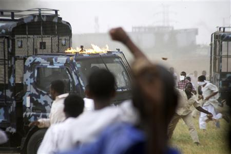 Sudanese demonstrators burn a police vehicle at the U.S embassy in Khartoum September 14, 2012. Three people were killed on Friday during a demonstration against an anti-Islam film outside the U.S. embassy in Sudan, Sudan's state radio said. REUTERS/Stringer