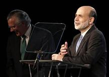 Federal Reserve Chairman Ben Bernanke (R) addresses members of the Dallas Regional Chamber as Richard Fisher, president and CEO of the Federal Reserve Bank of Dallas, laughs in Dallas, Texas April 7, 2010. REUTERS/Mike Stone