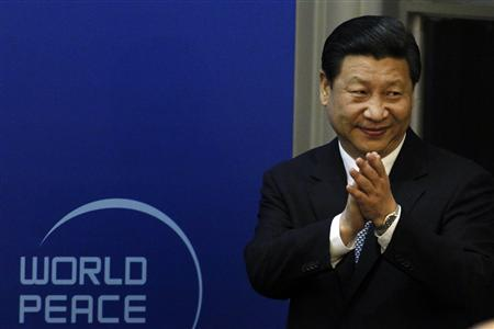 Chinese Vice President Xi Jinping arrives for the opening ceremony of the World Peace Forum held in Beijing in this July 7, 2012 file photo. REUTERS/Ng Han Guan/Pool/Files