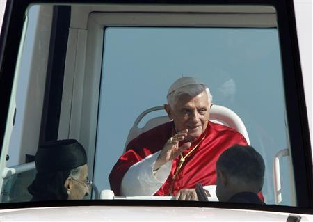 Pope Benedict XVI waves to the faithful from his Popemobile upon his arrival to conduct an open-air mass service at Beirut City Center Waterfront September 16, 2012. REUTERS/Sharif Karim