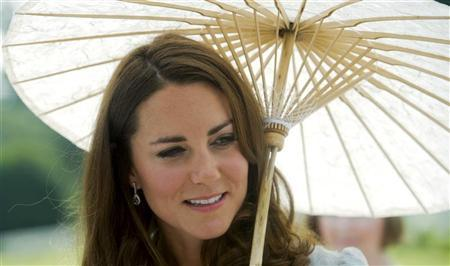 Catherine, Duchess of Cambridge walks at the Kranji Commonwealth War Cemetery, to pay her respects to the war dead, in Singapore September 13, 2012. REUTERS/Nicolas Asfouri/Pool