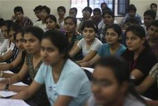 Students attend class at the Bansal Classes in Kota, in India's desert state of Rajasthan, August 13, 2012. A boom in India's management education sector that saw the number of business schools triple to almost 4,000 over the last five years has ended as students find expensive courses are no guarantee a well-paid job in a slowing economy. India's seemingly unstoppable economic rise, an aspiring middle class' desire to stand out in a competitive job market, and a lucrative opportunity for investors fuelled a bubble in business education that is now starting to deflate. REUTERS/Ahmad Masood