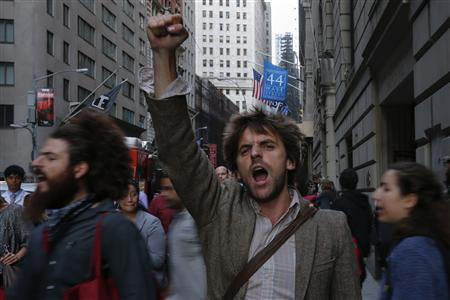 Occupy Wall Street activists shout slogans and march in Lower Manhattan's financial district on the one-year anniversary of the movement in New York September 17, 2012. REUTERS/Adrees Latif