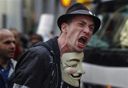 An Occupy Wall Street activist screams as he demonstrates in the financial district during the one-year anniversary of the movement in New York, September 17, 2012. REUTERS/Lucas Jackson