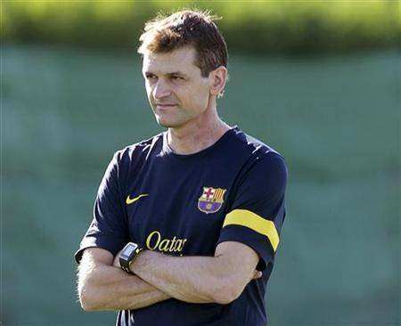 Barcelona's coach Tito Vilanova looks to his players during the training session at Joan Gamper training camp, near Barcelona, July 19, 2012. REUTERS/Gustau Nacarino/Files