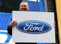 Alan Mulally, President and CEO of Ford Motor Company attends a launch event for the New 2013 Ford Fusion Hybrid car in New York's Times Square, September 18, 2012. REUTERS/Mike Segar