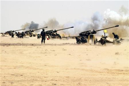 An undated handout photo distributed by the Syrian News Agency (SANA) on July 8, 2012, shows Syrian armed forces during a live ammunitions exercise in an undisclosed location. REUTERS/SANA/Handout