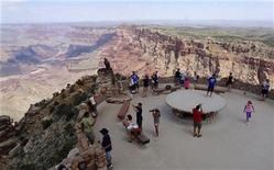Tourists gather at the south Rim of the Grand Canyon near Tusayan, Arizona August 10, 2012. REUTERS/Charles Platiau