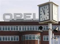 A clock shows five to twelve at the Opel plant of Bochum in March 28, 2012. REUTERS/Ina Fassbender