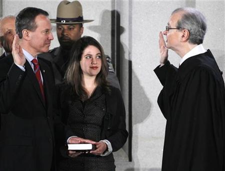 New York Attorney General Eric Schneiderman (L) is sworn in by Chief Judge Jonathan Lippman during a ceremony at the Capitol in Albany, New York, January 1, 2011. REUTERS/Mike Groll/Pool