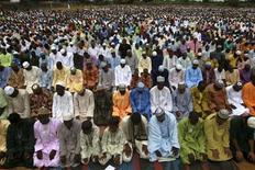 Muslims pray in an open ground during Eid al-Fitr celebrations, marking the end of the holy month of Ramadan in Nigeria's commercial capital Lagos August 19, 2012. REUTERS/Akintunde Akinleye