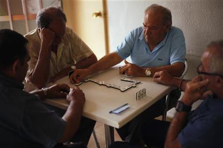 Pensioners play dominoes at a bar in Ronda, near Malaga September 18, 2012. REUTERS/Jon Nazca
