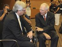 President of Eurogroup Jean-Claude Juncker (L) speaks with German Finance Minister Wolfgang Schaeuble at the EU Informal Economic and Financial Affairs Council (ECOFIN) Meeting in Nicosia, Cyprus September 14, 2012. REUTERS/Andreas Manolis