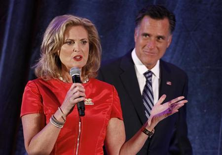 U.S. Republican presidential nominee and former Massachusetts Governor Mitt Romney (R) listens to his wife Ann speak at a campaign fundraiser in Dallas, Texas September 18, 2012. REUTERS/Jim Young