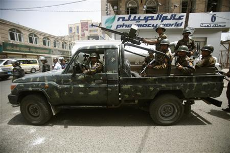 Riot policemen patrol outside the French embassy in Sanaa September 20, 2012. REUTERS/Khaled Abdullah