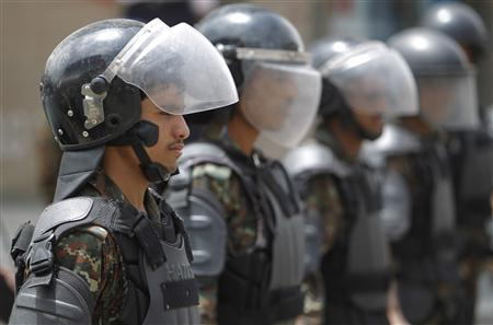 Riot policemen stand guard outside the French embassy in Sanaa September 20, 2012. REUTERS/Khaled Abdullah
