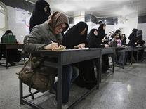 Women fill in their ballots during Iran's parliamentary elections at a mosque in southern Tehran March 2, 2012. Iranians voted on Friday in a parliamentary election likely to reinforce Supreme Leader Ayatollah Ali Khamenei's power over rival hardliners led by President Mahmoud Ahmadinejad. REUTERS/Raheb Homavandi