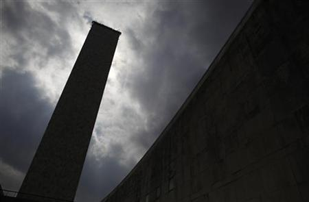 The United Nations General Assembly building is seen silhouetted during the 66th United Nations General Assembly at the U.N. Headquarters in New York, September 22, 2011. REUTERS/Eric Thayer