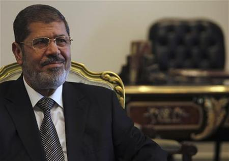 Egypt's President Mohamed Mursi meets Iran's Foreign Minister Ali Akbar Salehi (not pictured) at the presidential palace in Cairo September 18, 2012 during a meeting on the Syria crisis convened by regional powers. REUTERS/Amr Abdallah Dalsh