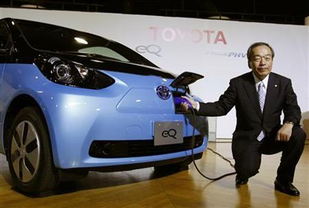Toyota Motor Corp's Executive Vice President Takeshi Uchiyamada poses next to the company's newly developed compact electric vehicle eQ after a news conference in Tokyo September 24, 2012. Toyota will release 21 new hybrid vehicle models over the next three years, the Japanese automaker said on Monday. REUTERS/Yuriko Nakao