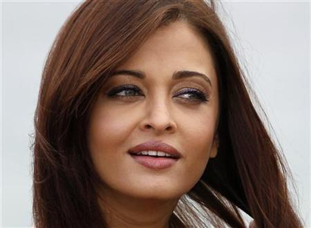 Bollywood actress Aishwarya Rai Bachchan poses during a beach front photocall at the 64th Cannes Film Festival, May 13, 2011. REUTERS/Yves Herman