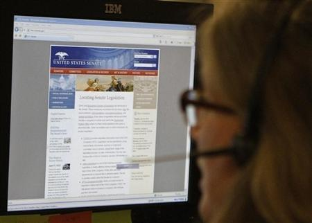 A journalist checks the U.S. Senate's website in Washington, D.C. June 13, 2011, after it was hacked over the weekend. REUTERS/Stelios Varias