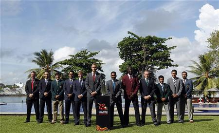 Cricket captains from various countries pose with the trophy during an official World Twenty 20 captains photograph in Colombo, September 15, 2012. The tournament runs from September 18 to October 7 in Sri Lanka. REUTERS/Dinuka Liyanawatte