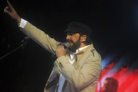 Dominican singer Juan Luis Guerra performs during the concert ''A Son de Guerra Tour'' at the Olympic Stadium in Santo Domingo June 16, 2012. REUTERS/Ricardo Rojas