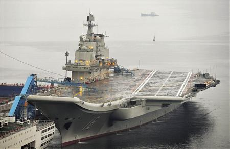 China's first aircraft carrier, which was renovated from an old aircraft carrier that China bought from Ukraine in 1998, is seen docked at Dalian Port, in Dalian, Liaoning province in this September 22, 2012 file photo. China's first aircraft carrier, the Liaoning, officially entered naval ranks on September 25, 2012 the country's Ministry of Defence announced, in a move that it said would help project maritime power and defend Chinese territory. REUTERS-Stringer-Files