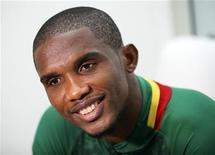 Cameroon's Samuel Eto'o smiles during an interview following the launch of Puma's kits for nine African national soccer teams at the Design Museum in London November 7, 2011. REUTERS/Olivia Harris
