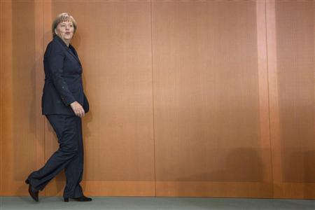 German Chancellor Angela Merkel arrives at a cabinet meeting at the Chancellery in Berlin, September 26, 2012. REUTERS/Thomas Peter