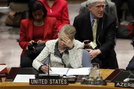 U.S. Secretary of State Hillary Clinton reads her notes during a Security Council meeting to discuss Peace and Security in the Middle East during the 67th United Nations General Assembly at the U.N. Headquarters in New York, September 26, 2012. REUTERS/Keith Bedford