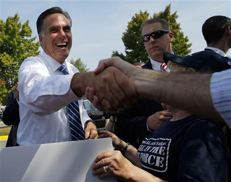 Republican presidential candidate and former Massachusetts Governor Mitt Romney greets supporters gathered outside American Legion Post 176 in Springfield, Virginia September 27, 2012. REUTERS/Brian Snyder
