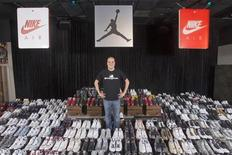 "Jordan Michael Geller poses with his collection of the Nike Air Jordan Retro line at the ""ShoeZeum"" in downtown Las Vegas, Nevada September 25, 2012. REUTERS/Steve Marcus"