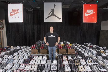 Jordan Michael Geller poses with his collection of the Nike Air Jordan Retro line at the ''ShoeZeum'' in downtown Las Vegas, Nevada September 25, 2012. REUTERS/Steve Marcus