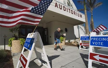 A voter leaves a polling station after casting his ballot in the Florida Republican presidential primary election in Sarasota, Florida January 31, 2012. REUTERS/Steve Nesius