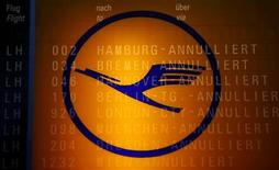 The logo of German air carrier Lufthansa and the cancelled flights on a flight schedule board are seen at the Fraport airport in Frankfurt, September 7, 2012. REUTERS/Kai Pfaffenbach