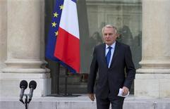 French Prime Minister Jean-Marc Ayrault walks to deliver a speech after the weekly cabinet meeting at the Elysee Palace in Paris, September 28, 2012. Ayrault announced a budget bill for 2013 that commits France to 30 billion euros ($39 billion) of tax hikes and spending cuts with the goal of reducing the public deficit to 3 percent of GDP next year to honour the country's European commitments. REUTERS/Philippe Wojazer