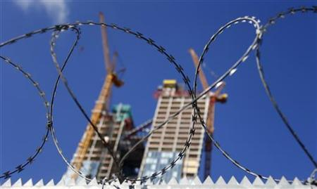 The partially built new headquarters of the European Central Bank (ECB) is seen behind a fence with razor wire at its construction site in Frankfurt, September 19, 2012. REUTERS/Kai Pfaffenbach