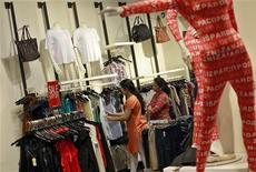 People shop for clothes at a store during a seasonal sale inside a shopping mall in Mumbai July 14, 2012. REUTERS/Danish Siddiqui