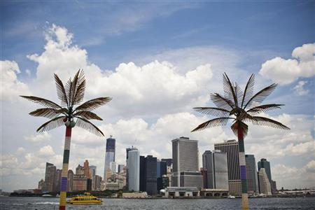 The skyline of Manhattan's Financial District is seen from Governors Island, in New York, July 3, 2012. REUTERS/Andrew Burton