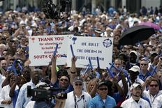 Workers celebrate as the first 787 Dreamliner passenger jet to be assembled at Boeing's South Carolina facility is rolled out during a ceremony in North Charleston, in this April 27, 2012, file photo. One of Boeing's chief labour unions staged rallies in and around Seattle this week, calling attention to a vote set for October 1, 2012, that will show whether workers are willing to accept a less generous contract offered by Boeing Co. or move closer to a strike. REUTERS/ Mary Ann Chastain/Files