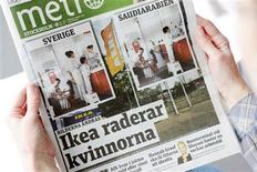 A person holds a copy of the Metro daily newspaper in Stockholm October 1, 2012, with its front page comparing images for the IKEA catalogues in Sweden (L) and Saudi Arabia (R) for next year. The Saudi version of the the otherwise identical photos, does not show a women. REUTERS/Henrik Montgomery/Scanpix/Files