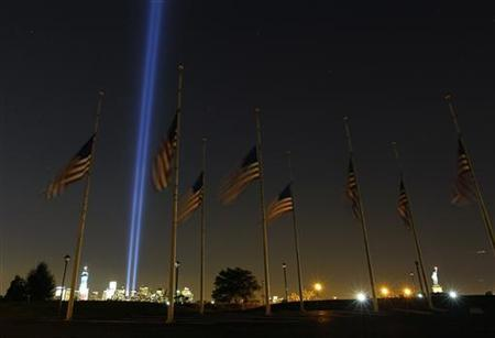 The Tribute in Light is illuminated on the skyline of New York in Jersey City, New Jersey September 11, 2012. REUTERS/Gary Hershorn
