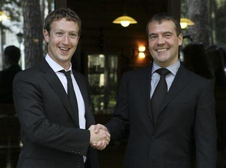 Russian Prime Minister Dmitry Medvedev (R) shakes hands with Facebook CEO Mark Zuckerberg during their meeting at the Gorki residence outside Moscow, October 1, 2012. REUTERS/Ekaterina Shtukina/RIA Novosti/Pool