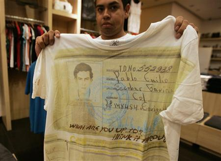 c9839b60f A salesperson shows a T-shirt with a picture of late Colombian cocaine  kingpin Pablo Escobar at a store in Zapopan on the outskirts of Guadalajara  September ...