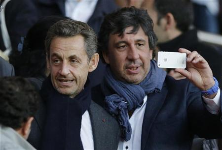 Former French President Nicolas Sarkozy (L) leaves the Parc des Princes stadium at the end of Paris St Germain's French Ligue 1 soccer match against Sochaux in Paris, September 29, 2012. REUTERS/Christian Hartmann